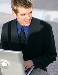 Photo - Business man using a computer