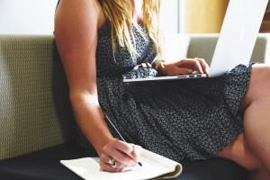 Photo: Woman taking notes